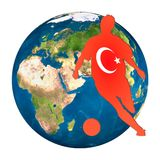Turkey. A footballer silhouette in front of globe symbolizing Turkish Team Stock Photos