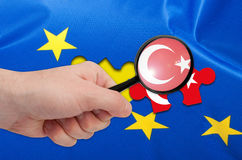 Turkey Accession - Flag of European Union. Turkey Accession - Detail of Silky Flag of Blue European Union EU Flag Drapery With Turkish Puzzle Piece royalty free stock photos