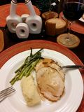 Turkey accompanied by asparagus and mashed potatoes stock image