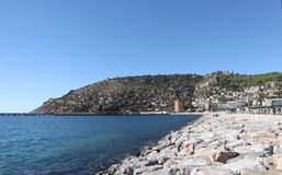 Sea port of Alanya, big rocks on the shore, mountain with fortress stock photography