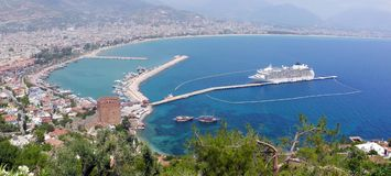 Turkey, Alanya - red tower and harbor Stock Images