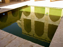 Turkey and the ancient building in the water. Old archs reflected in the water Royalty Free Stock Photography