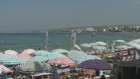 Turkey, Antalya, August 20, 2015 : beach, sun umbrellas,people swim and sunbathe on the beach. Resorts in Turkey, Antalya, people relax on the sea in summer stock video footage