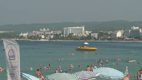 Turkey, Antalya, August 20, 2015 : beach, sun umbrellas,people swim and sunbathe on the beach. Resorts in Turkey, Antalya, people relax on the sea in summer stock footage