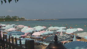 Turkey, Antalya, August 20, 2015 : beach, sun umbrellas,people swim and sunbathe on the beach. Resorts in Turkey, Antalya, people relax on the sea in summer stock video