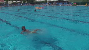 Turkey, Antalya, August 20, 2015 a man dives into the pool stock footage