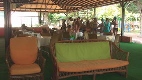 Turkey, Antalya, August 20, 2015, outdoor pavilion, people eating at the tables stock footage