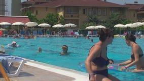Turkey, Antalya, August 20, 2015 : people swim and sunbathe on the beach the pool. Summer, Turkey, pool people swim and sunbathe stock footage