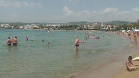 Turkey, Antalya, August 20, 2015 : people swim and sunbathe on the beach. Resorts in Turkey, Antalya, people relax on the sea in summer stock video footage