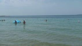 Turkey, Antalya, August 20, 2015 : people swim and sunbathe on the beach. Resorts in Turkey, Antalya, people relax on the sea in summer stock footage