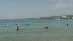 Turkey, Antalya, August 20, 2015 : people swim and sunbathe on the beach. Resorts in Turkey, Antalya, people relax on the sea in summer stock video