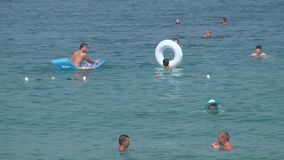 Turkey, Antalya, August 20, 2015 : people swim and sunbathe on the beach. Resorts in Turkey, Antalya, people relax on the sea in summer stock footage