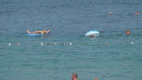 Turkey, Antalya, August 20, 2015 : people swim and sunbathe on the beach. Resorts in Turkey, Antalya, people relax on the sea in summer stock video footage