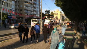 Turkey, Antalya, March 2016 bustling city by day and in the light of the sun. A view of the busy roadway, busy street, downtown, roadway, people go, go trams and stock video footage