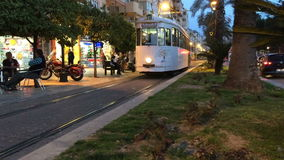 Turkey, Antalya - March 20, 2016: The city tram is moving from a stop on one of the streets in the central district of stock video