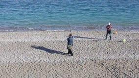 Turkey, Antalya, March 2016 Fishermen catch fish on a fishing rod on the beach. Fishermen catch fish on a fishing rod on the beach stock footage