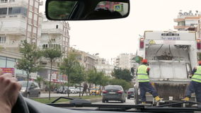 Turkey, Antalya, March 2016 Men's hands hold the steering wheel of the car General view of the busy roadway from a stock footage