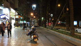 Turkey, Antalya - March 20, 2016: Old Tram moving in a central area of Kaleici in Antalya evening, March 20, 2016, Turkey. Old Tram moving in a central area of stock footage