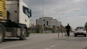 Turkey, Antalya, March 2016, panoramic view of the busy street. Roadway, drive cars and public transpot, running man, a man sweeping the street with a broom stock footage