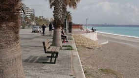 Turkey, Antalya, March 2016, panoramic view of the lively quay, men and women walk. Ing, man and woman are running along the waterfront in daylight, a woman stock video
