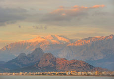 Turkey. Antalya. Mediterranean sea. Sunrise view. On the city, beach and mountains Stock Images