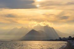 Turkey. Antalya. Mediterranean sea. Sunset. View on the beach and mountains Stock Photos