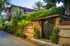 Turkey, Antalya, October 14, 2018. Cozy apartment building with many green plants.