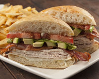 Turkey and avocado club sandwich Royalty Free Stock Images