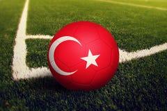 Turkey ball on corner kick position, soccer field background. National football theme on green grass.  vector illustration
