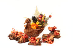 Turkey Basket with Cinnamon Stick. Napkin Holders with flowers, cones and fall colors, isolated on white Stock Photos