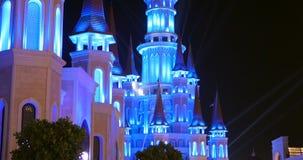 Turkey, Belek - 2017 October 4: Beautiful castle in Land of Legends theme park. Turkey, Belek - 2017 October 4: Beautiful illuminated fairy castle in Land of stock footage