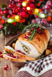Turkey breast for holidays. Stuffed turkey breast with baked vegetables and spices against holiday lights background stock photos
