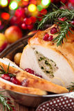 Turkey breast for holidays. Stuffed turkey breast with baked vegetables and spices against holiday lights background stock image