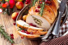 Turkey breast for holidays. Stuffed turkey breast with baked vegetables and spices against holiday lights background royalty free stock images