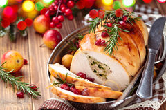 Turkey breast for holidays. Stuffed turkey breast with baked vegetables and spices against holiday lights background stock images
