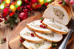 Turkey breast for holidays. Stuffed turkey breast with pomegranate and rosemary on cutting board royalty free stock images