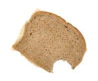 Turkey breast sandwich on wheat bread bitten Royalty Free Stock Photography