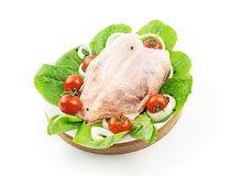 Turkey breast on a wooden tray. With tomatoes on white background Royalty Free Stock Photos