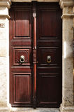 In turkey brown old craftmanship door and cat. Very beautiful brown historic door stock photography