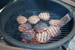 Turkey burgers on grill Royalty Free Stock Photography