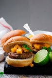 Turkey burgers with mango salsa.style rustic. Selective focus Royalty Free Stock Image
