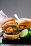 Turkey burgers with mango salsa.style rustic Royalty Free Stock Image