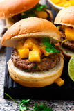 Turkey burgers with mango salsa.style rustic. Selective focus Royalty Free Stock Photos