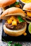 Turkey burgers with mango salsa.style rustic Royalty Free Stock Photos