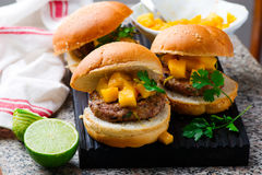 Turkey burgers with mango salsa.style rustic. Selective focus Stock Images