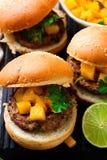 Turkey burgers with mango salsa.style rustic. Selective focus Stock Photos