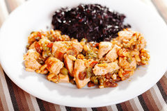 Turkey with capers and wild rice Stock Images