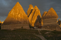 Turkey, Cappadocia. Bizarre rock in the light of the setting sun Stock Images