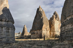 Turkey. Cappadocia. Fairy chimneys in Goreme. (Gereme) with old christian caves Stock Photography