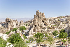 Turkey, Cappadocia. Open-air museum of Goreme. In the center of the picture rock with artificial caves - Nunnery Kyzlar, XI c. Stock Photography